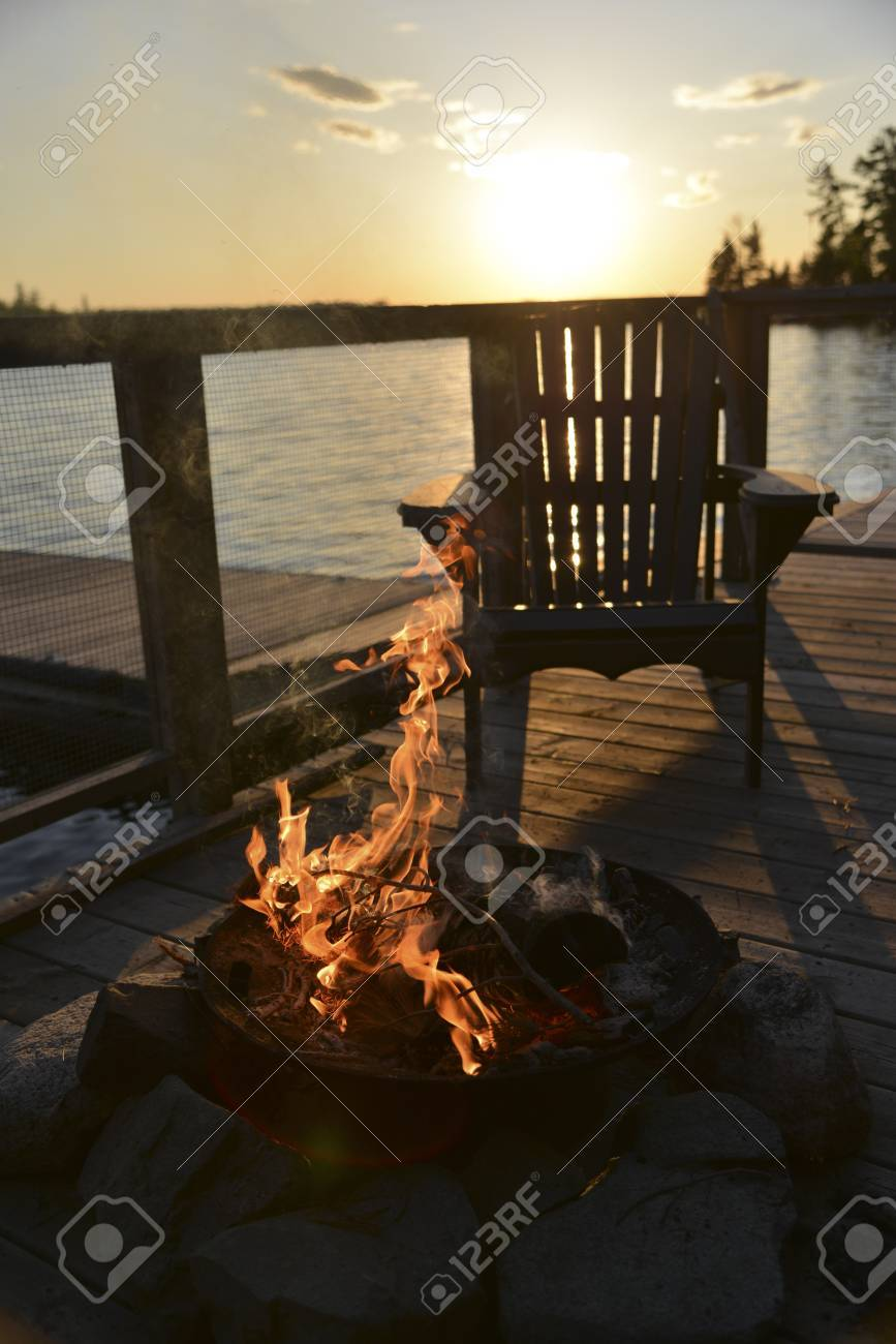Adirondack Chair And Campfire On A Dock, Lake Of The Woods, Keewatin,  Ontario