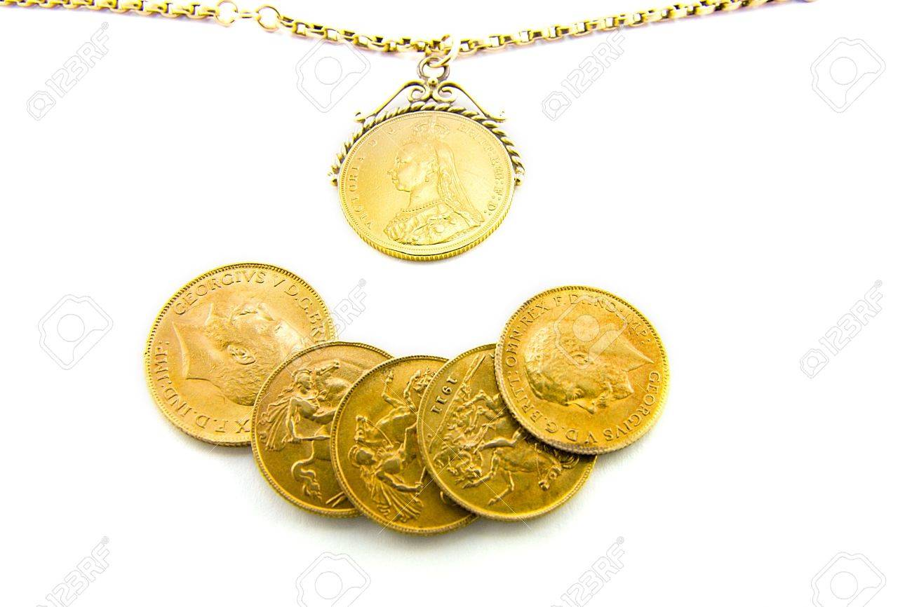 Five gold sovereigns with a sovereign on a chain with a white five gold sovereigns with a sovereign on a chain with a white background stock photo aloadofball Image collections