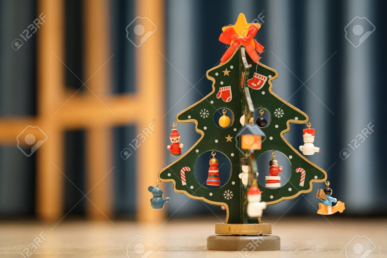 Painted Wooden Christmas Tree With Blue Background And Copy Space Stock Photo Picture And Royalty Free Image Image 90172136