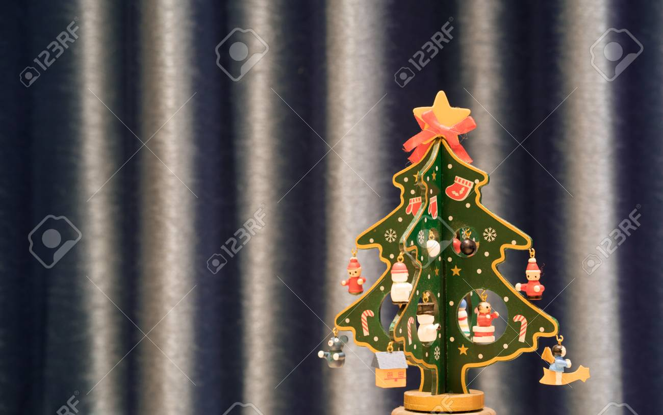 Painted Wooden Christmas Tree With Blue Background And Copy Space Stock Photo Picture And Royalty Free Image Image 92064780