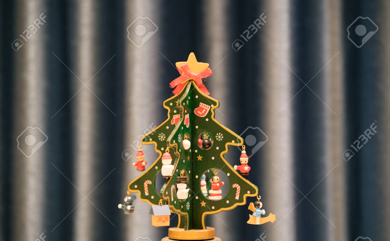 Painted Wooden Christmas Tree With Blue Background And Copy Space