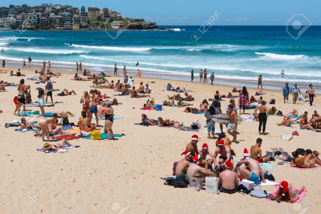 Christmas In Australia Santa.24th December 2018 Bondi Sydney Australia Group Of Young Men