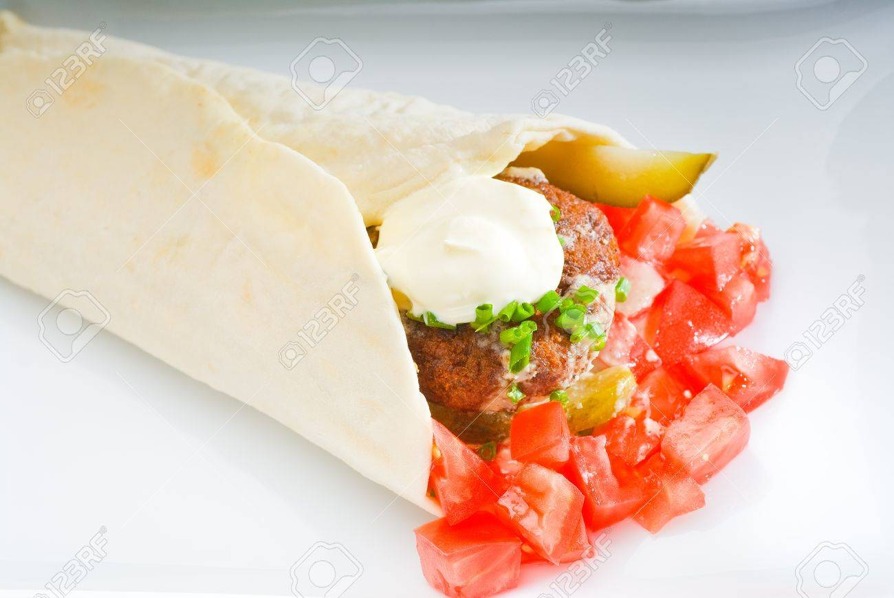 fresh traditional falafel wrap on pita bread with fresh chopped tomatoes Stock Photo - 9292143