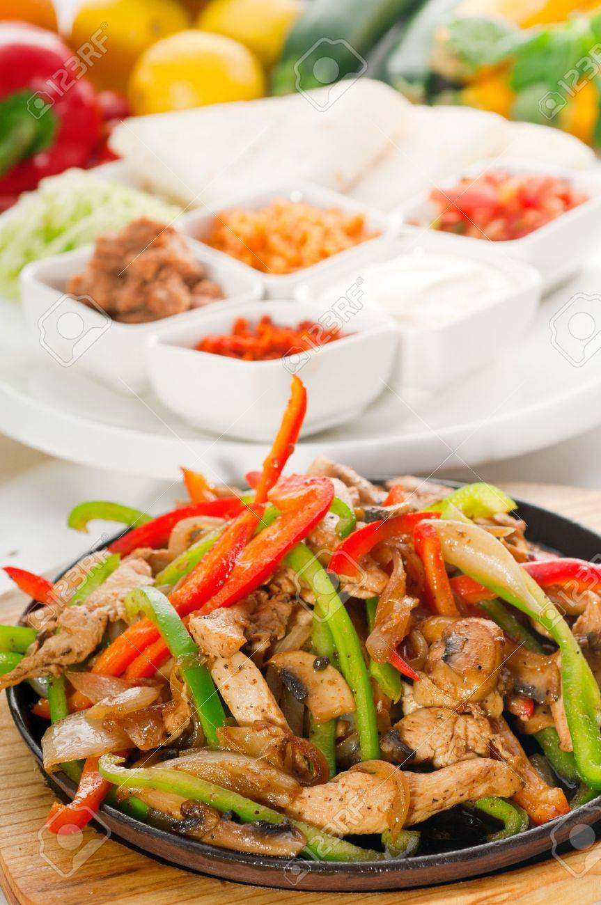 original fajita sizzling smoking hot served on iron plate and fresh vegetables on background ,MORE DELICIOUS FOOD ON PORTFOLIO Stock Photo - 10661180