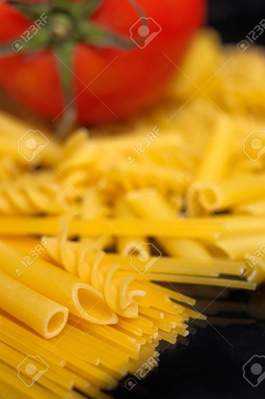 Italian pasta selection with fresh tomato over black closeup DOF Stock Photo - 12183730