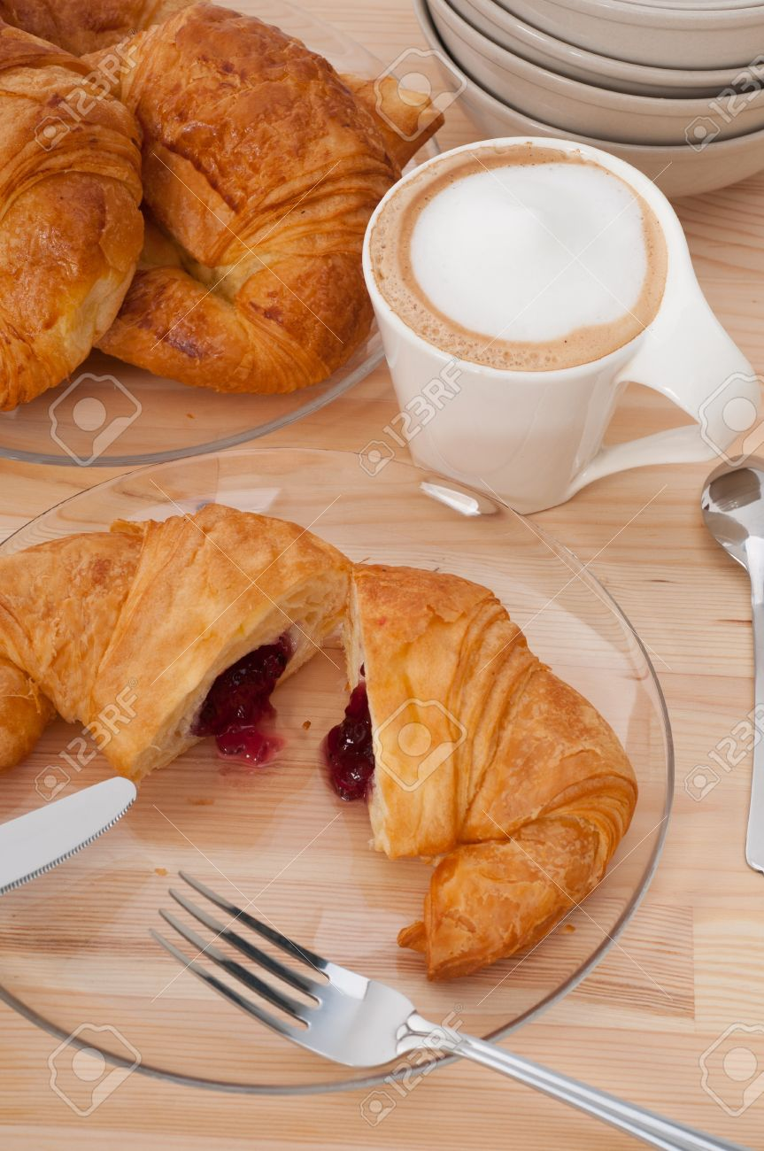 fresh croissant french brioche and coffee typical traditional Italian breakfast Stock Photo - 15377925