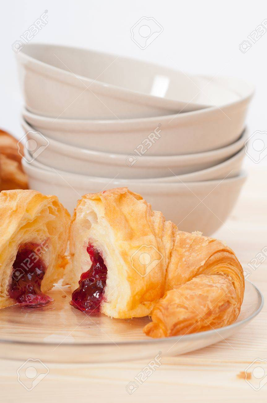 fresh baked croissant French brioche filled with berries jam Stock Photo - 15377917
