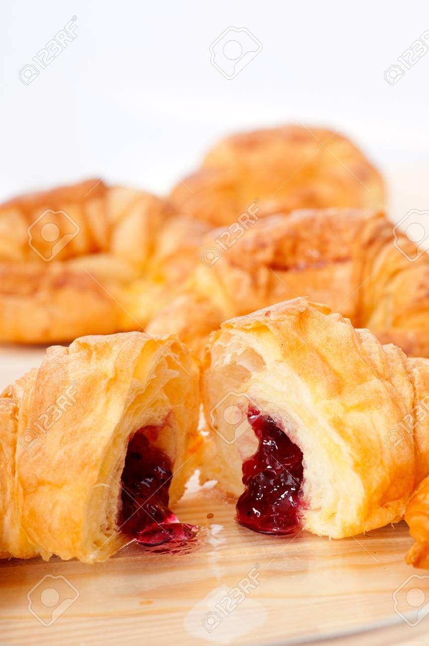 fresh baked croissant French brioche filled with berries jam Stock Photo - 15377918