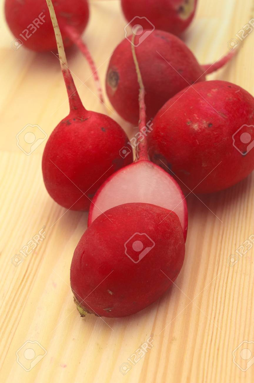 fresh red raw  raddish over pine wood table closeup Stock Photo - 16216810