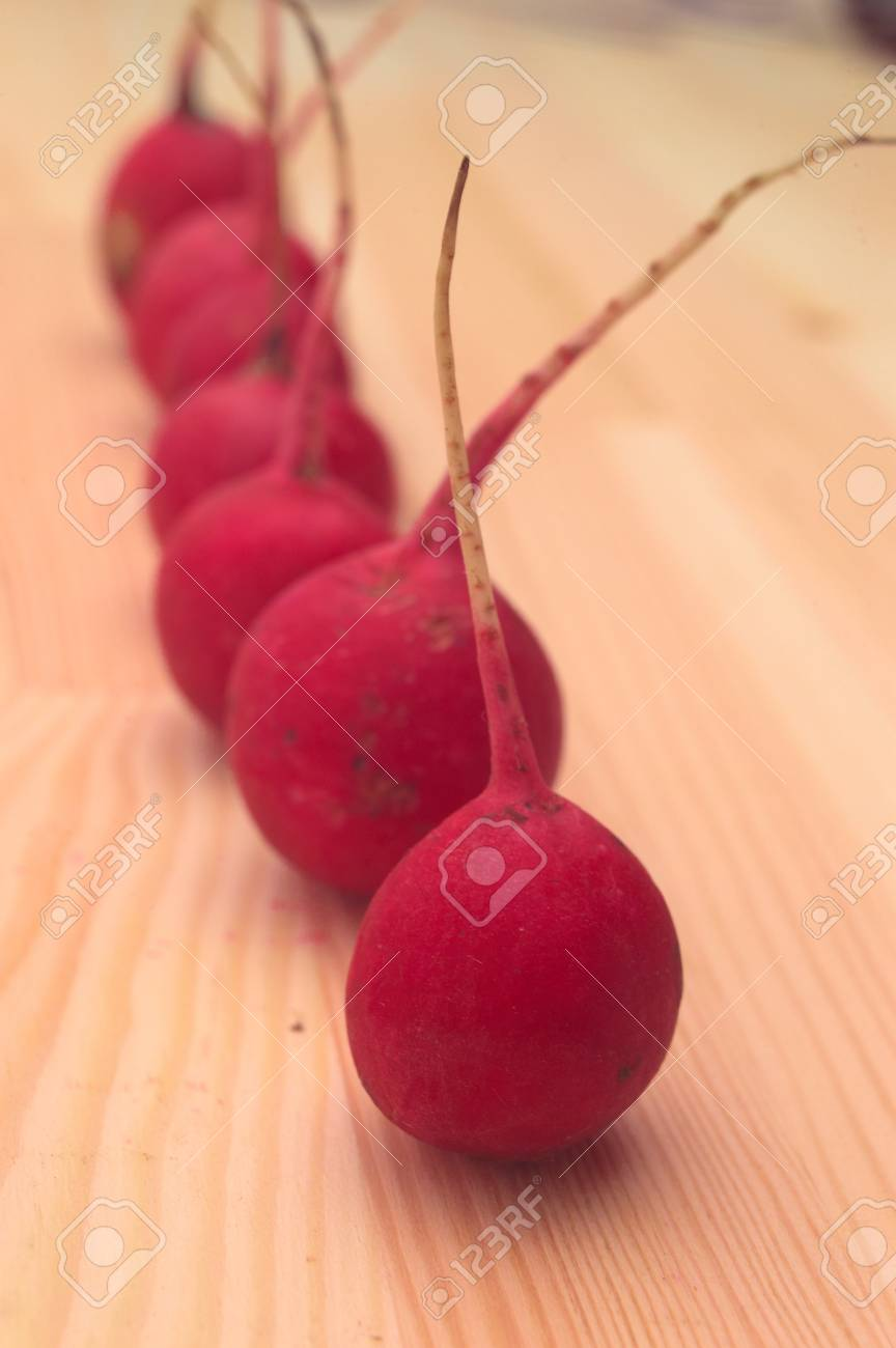fresh red raw  raddish over pine wood table closeup Stock Photo - 16216819
