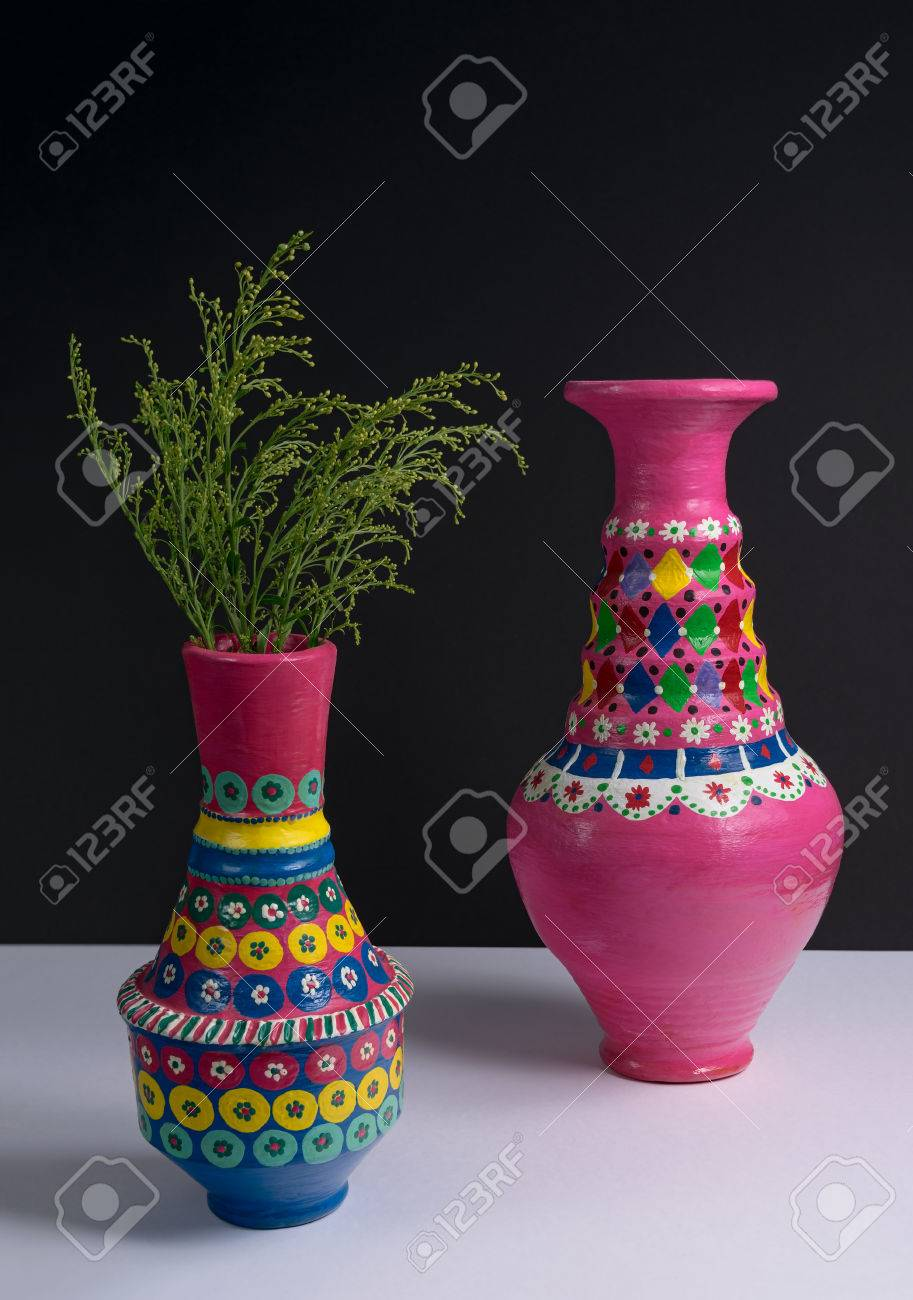 Still life of two artistic painted colorful handcrafted pottery still life of two artistic painted colorful handcrafted pottery vases and green plant branches with reviewsmspy