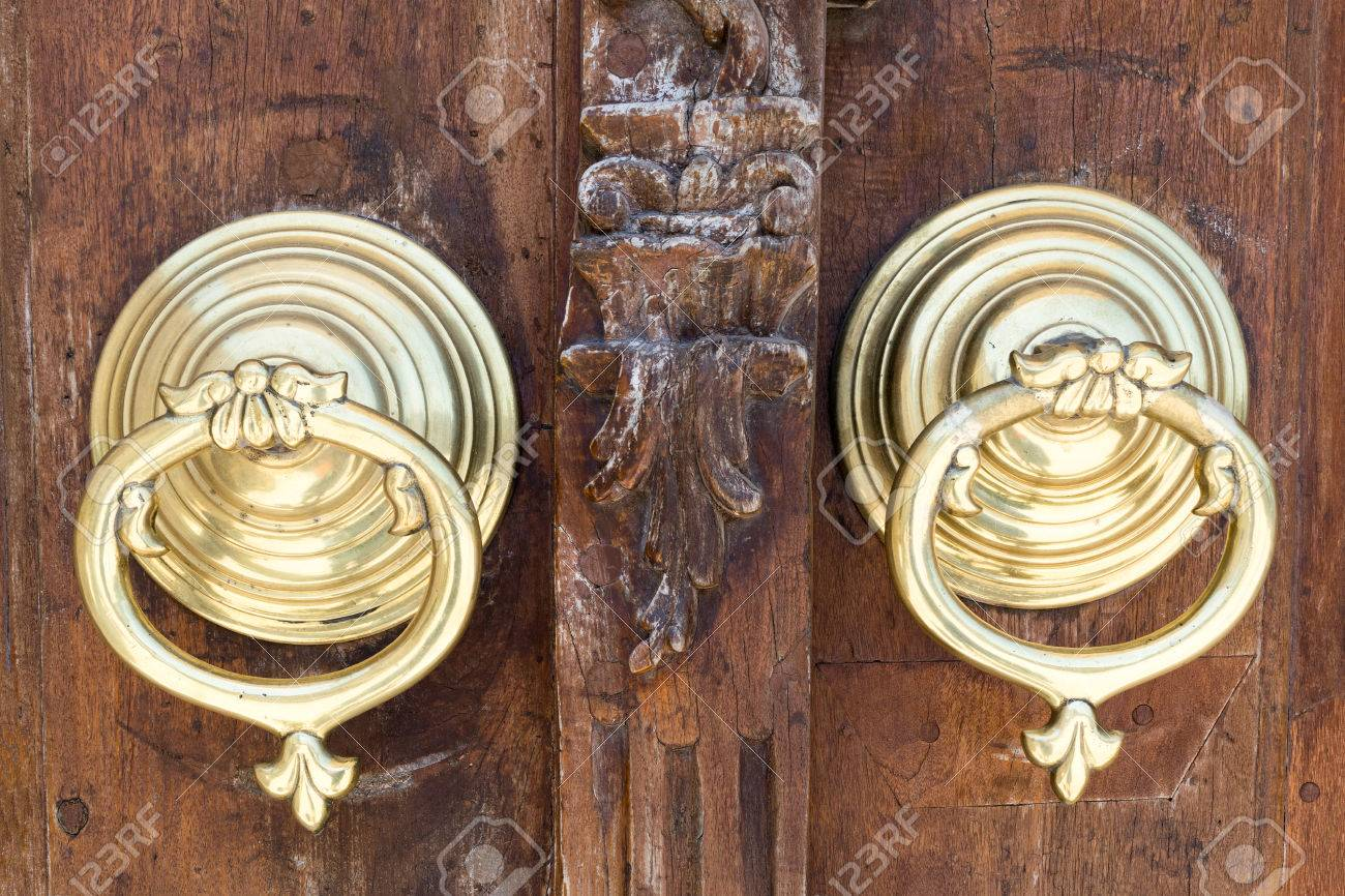Closeup Of Two Antique Copper Ornate Door Knockers Over An Aged Wooden Ornate  Door, Fatih
