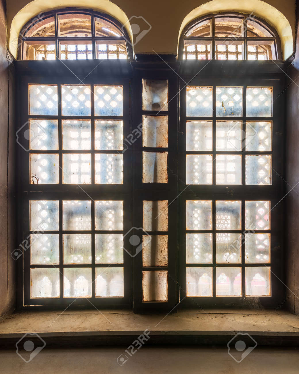 Large grunge vintage window with ornament located inside empty room - 151743132