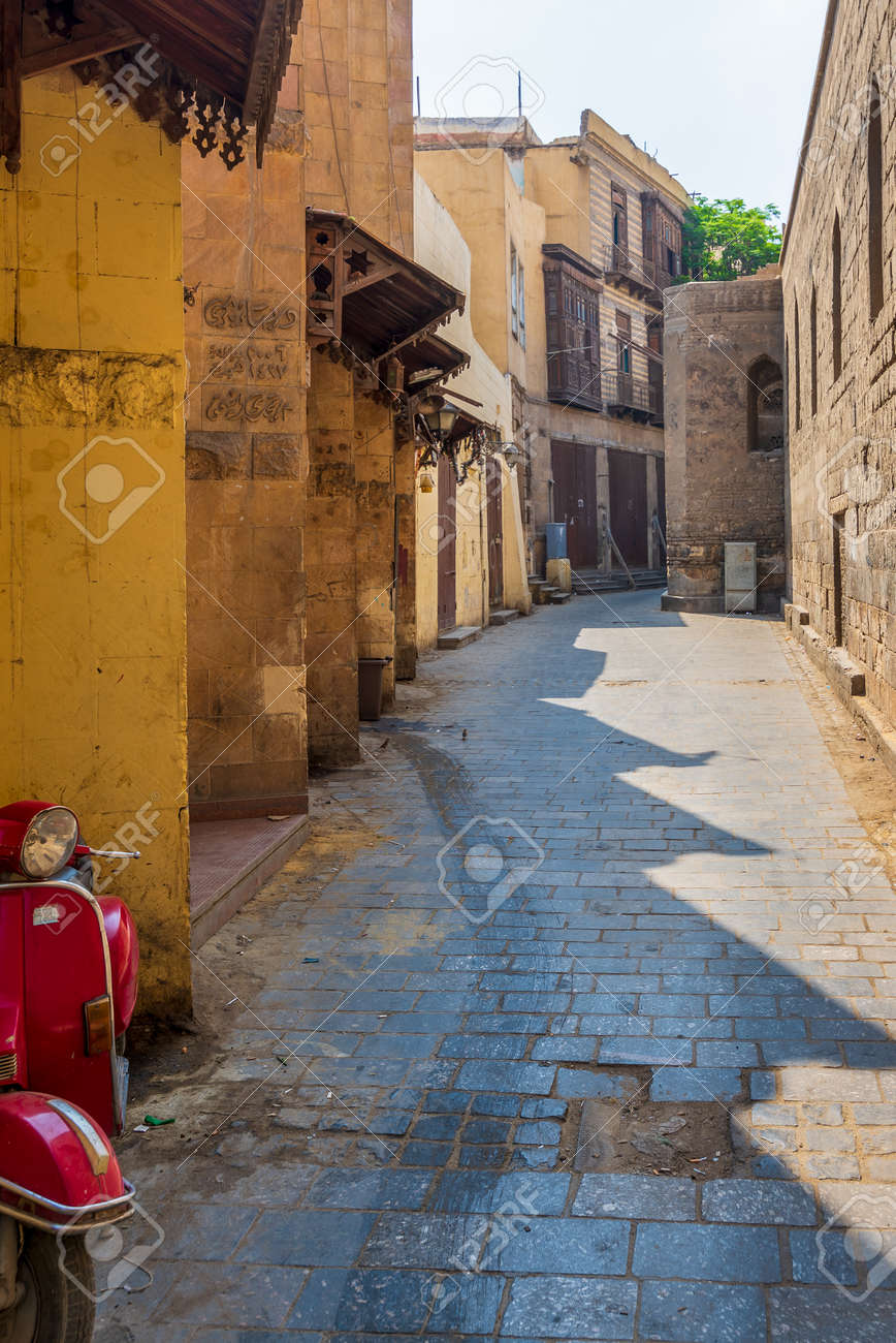 Cairo, Egypt - June 26 2020: Alley branching from historic Moez Street at Gamalia district, old Cairo, during Covid-19 lockdown period with closed shops and no pedestrians - 159985346