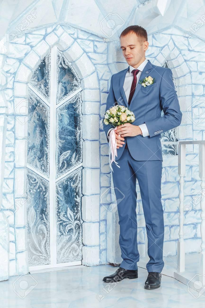 Portrait Handsome Groom In A Blue Suit Wait Bride In The Studio ...
