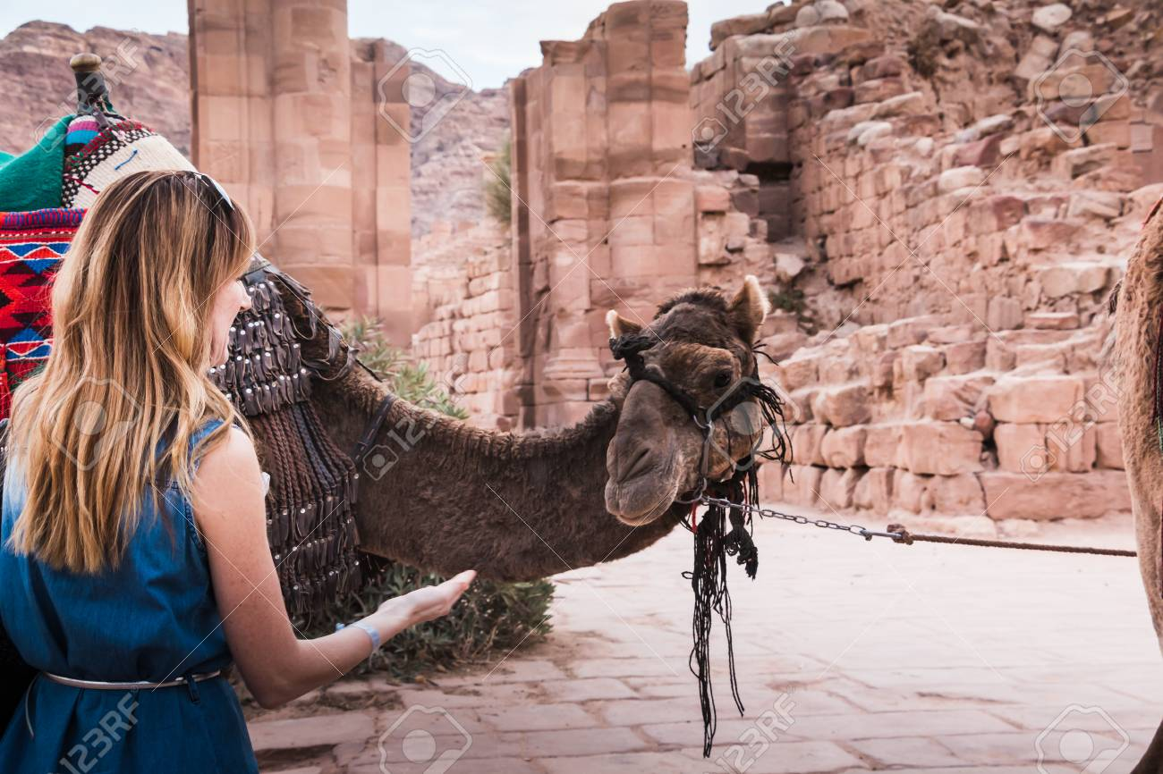 online store 11270 76cb4 Girl in old city Petra in the desert of Wadi Musa in Jordan, Stock Photo