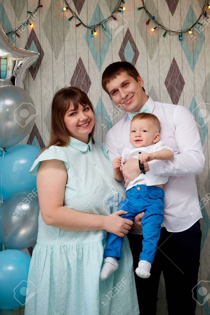 Couple with baby in the room mom dad and son together photoshoot at