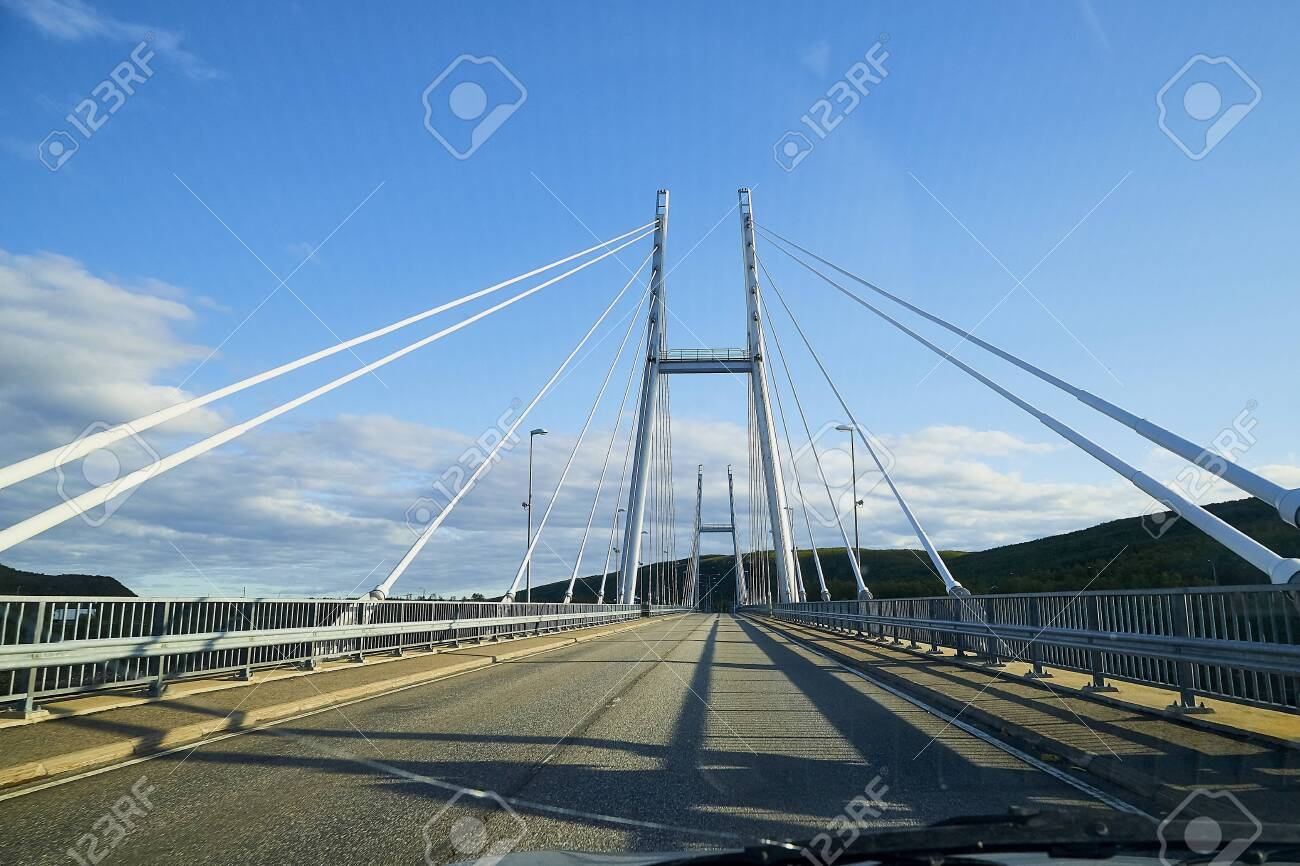 View on the bride and asphalt road through car's windscreen with a stripe relief in sunny summer, spring or autumn day - 146601874