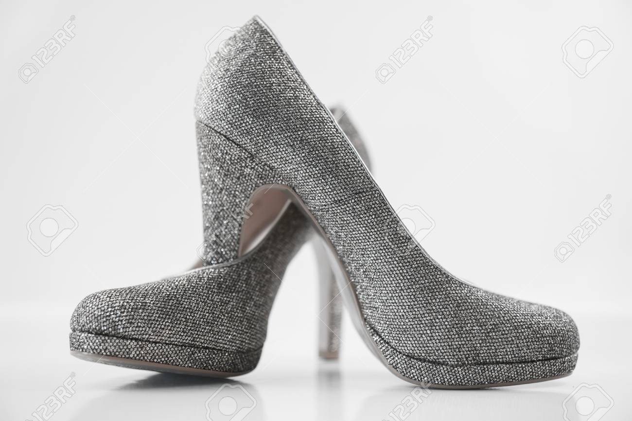 b0f687538e9 Stock Photo - Womens silver high heels on white background