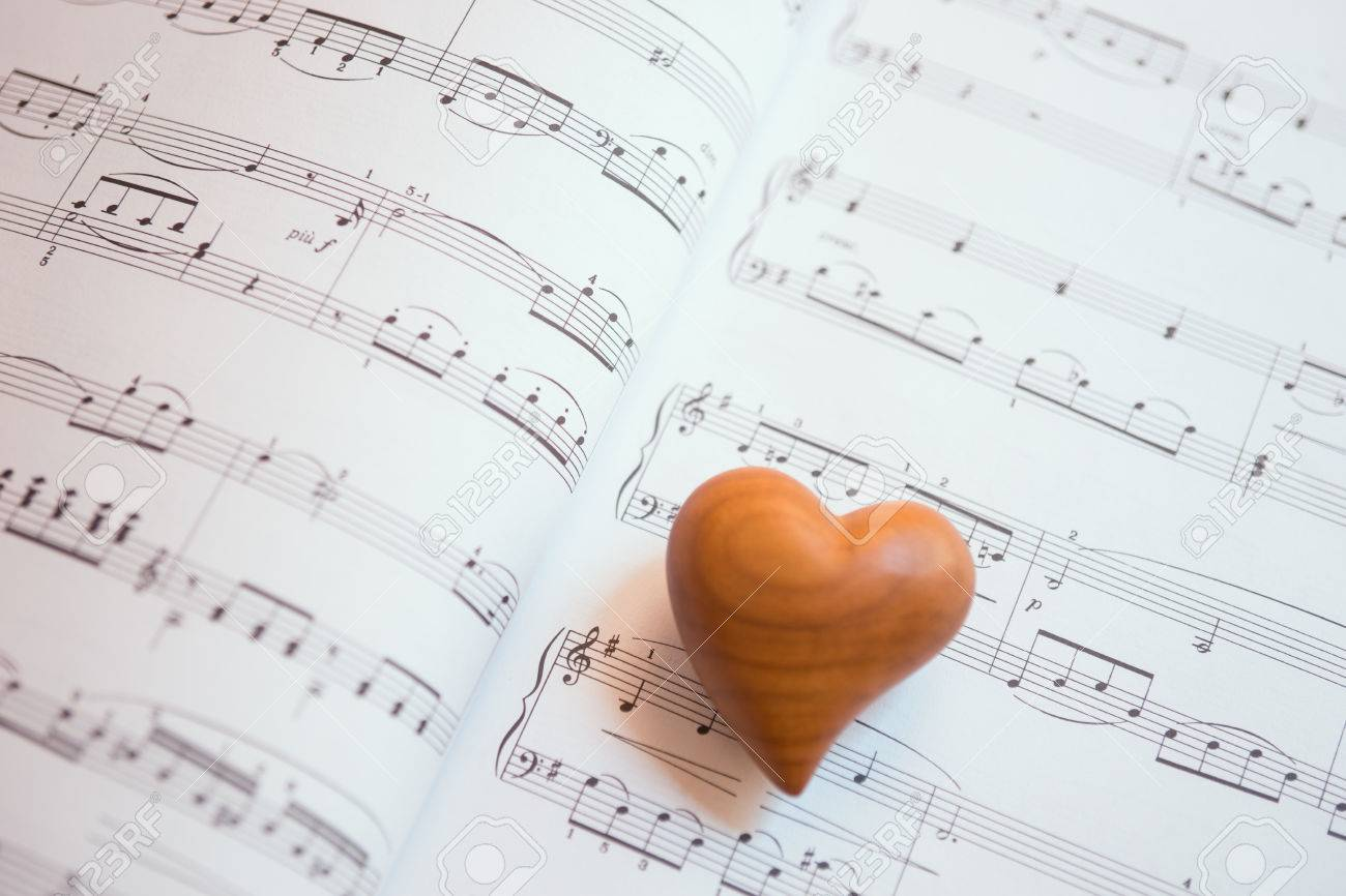 Wooden heart on a sheet of music love song stock photo picture and stock photo wooden heart on a sheet of music love song ccuart Image collections