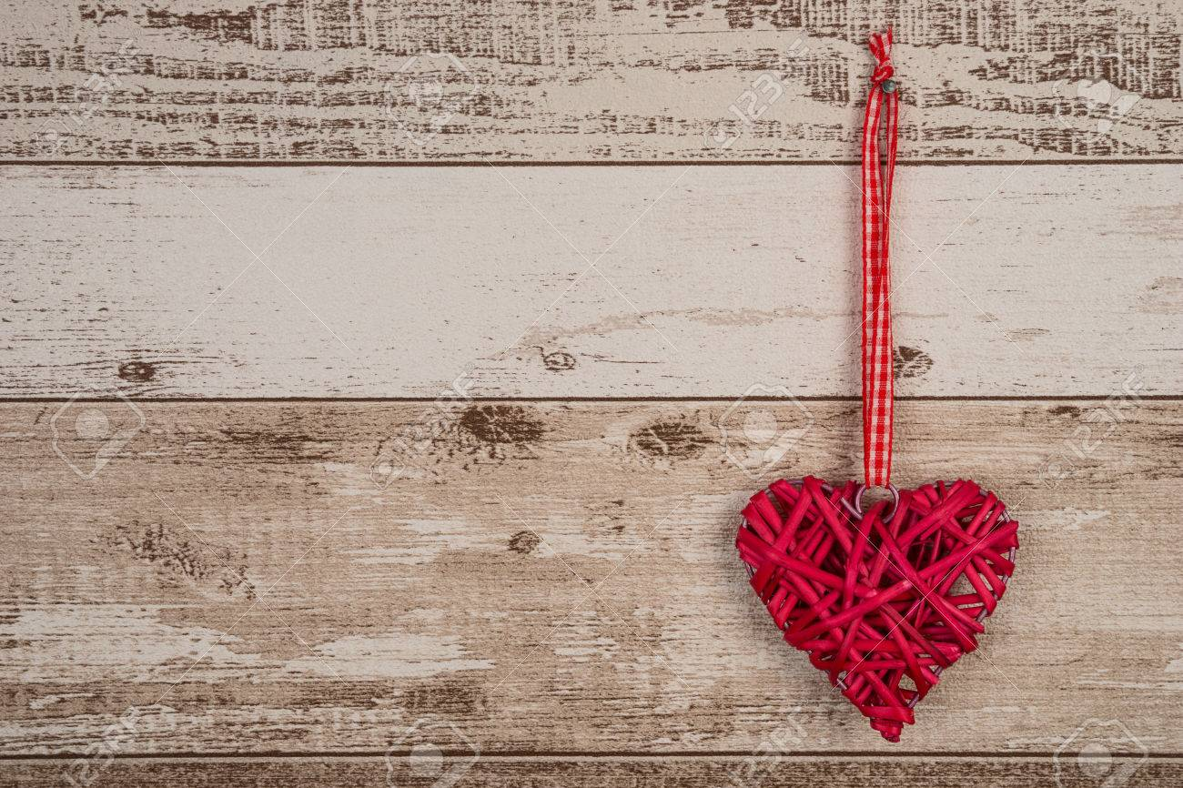 Red Wood Heart Hanging On Rustic Wooden Background Stock Photo
