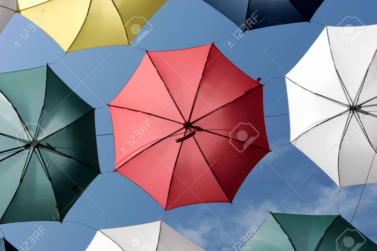 Colorful umbrellas of the rue du Cul-de-Sac, in the Petit Champlain district, in Quebec City - 131870855