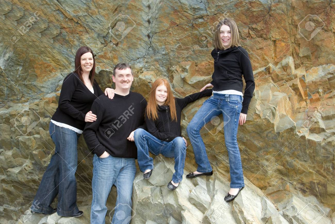 Casual portrait of active family of four taken on cliffs that were once the ocean floor Stock Photo - 5299814