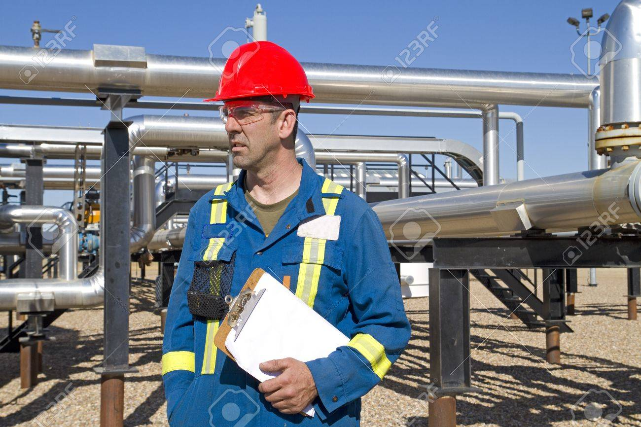 Male in full safety work gear inspects compressor site as daily duties Stock Photo - 8953722