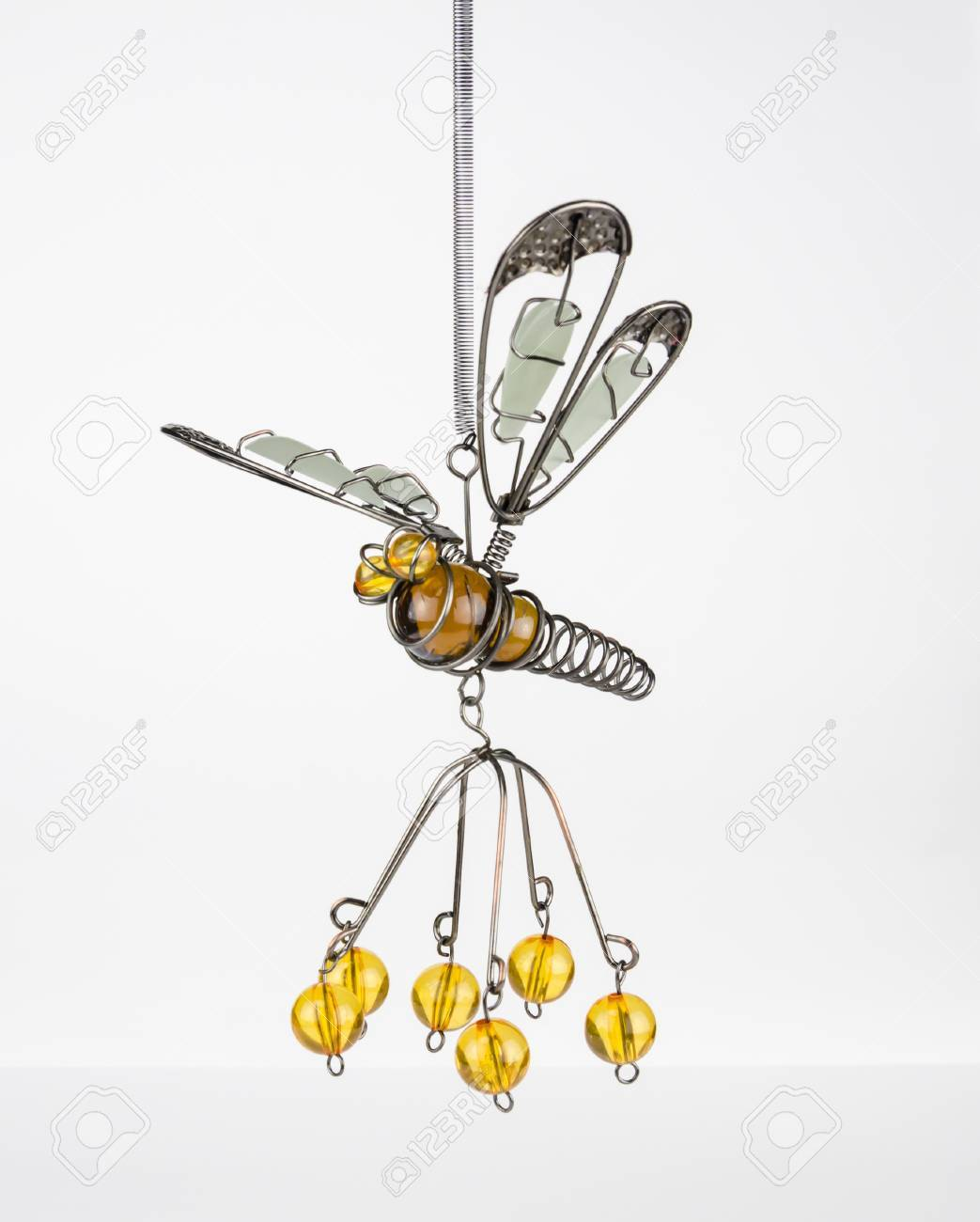 A Crafted Firefly Made Out Of Beads And Bent Wire Stock Photo ...