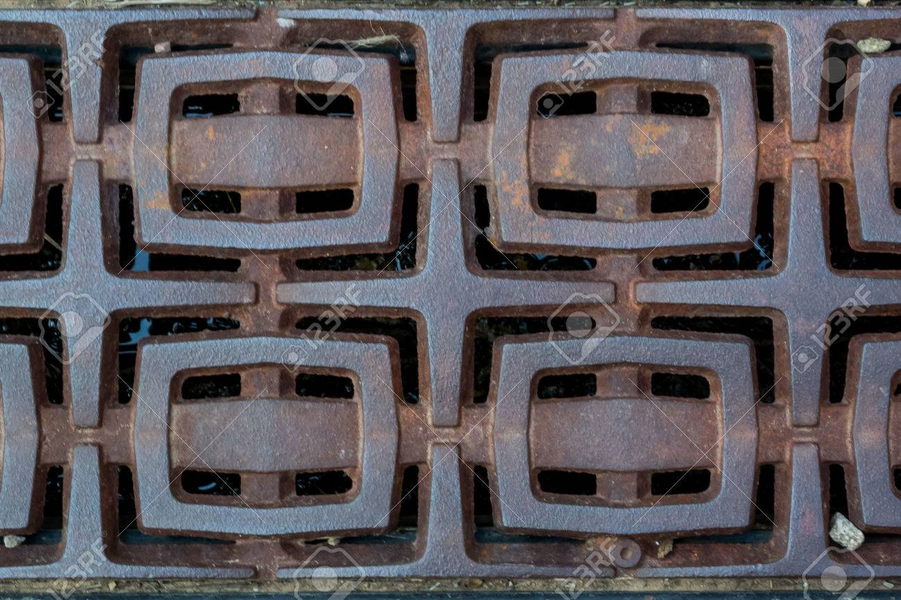 A Series Of Rectangles Appear As Buckles In A Decorative Metal