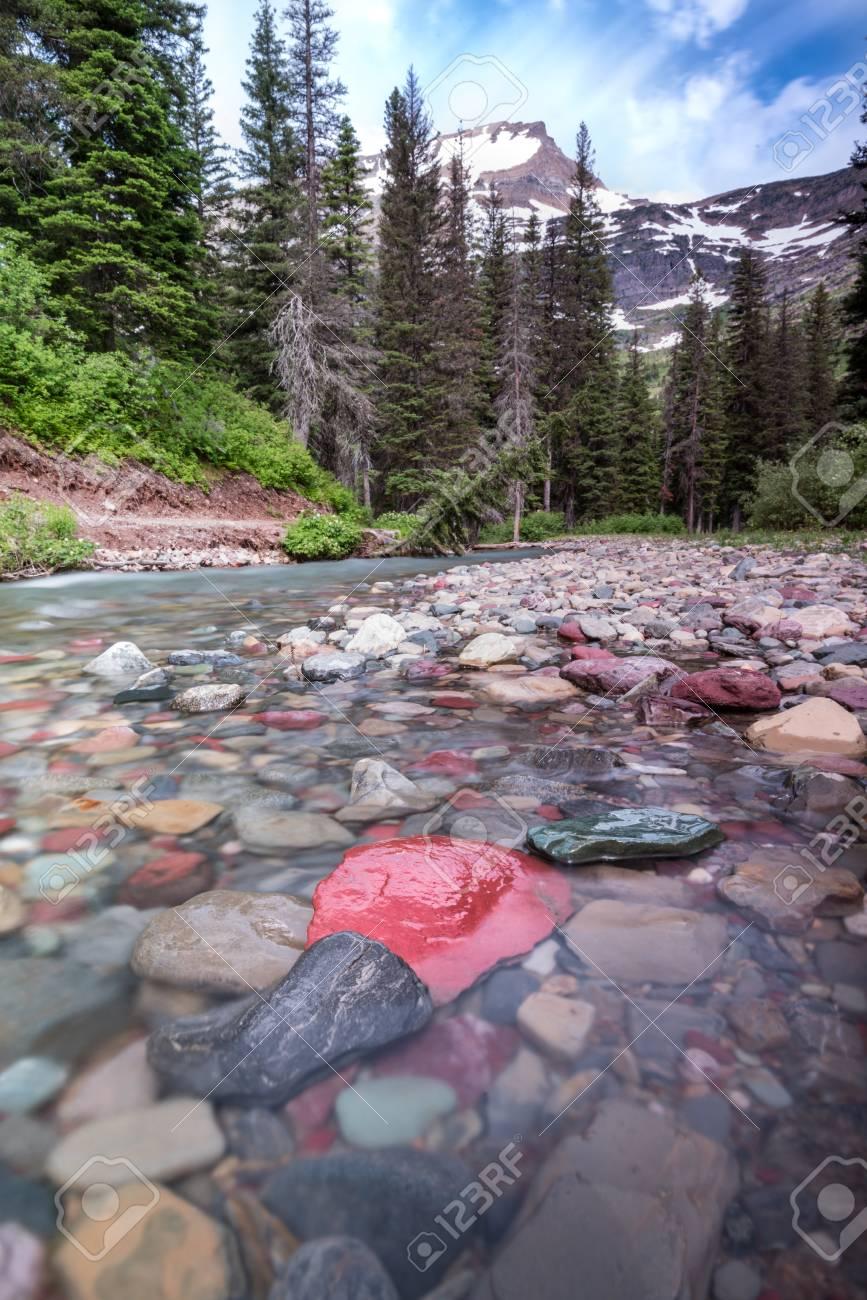 rocks in creek below mount grinnell in montana stock photo picture