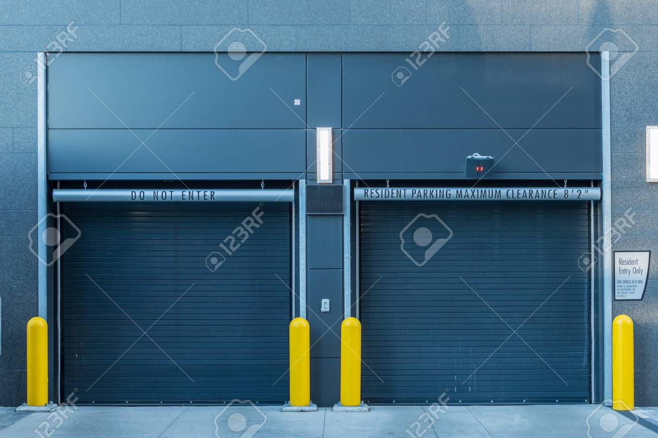 Closed Parking Garage Doors In Urban Apartment Building Stock Photo