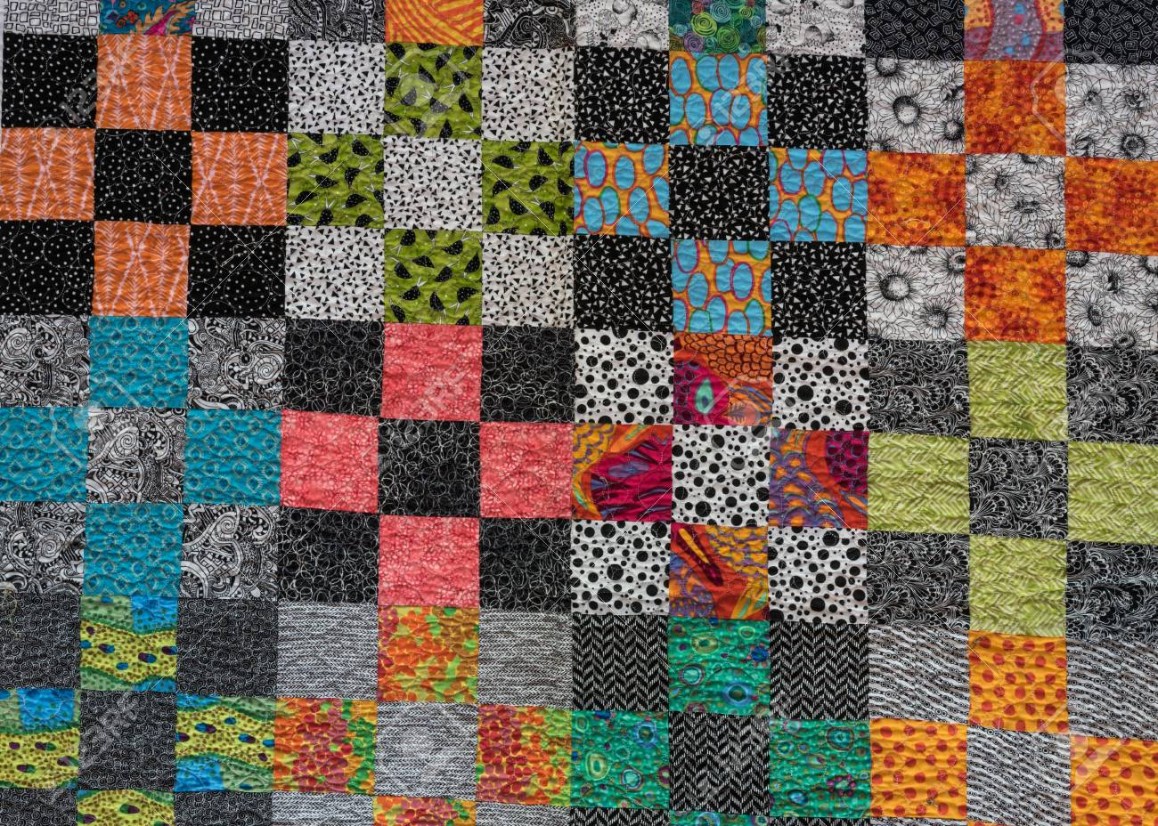 Black and white themed quilt with accent colors stock photo 97531864