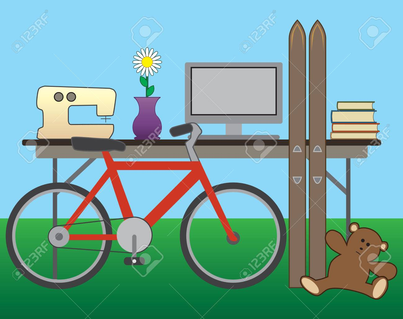 Backyard Items yard sale items on a folding table in a backyard royalty free
