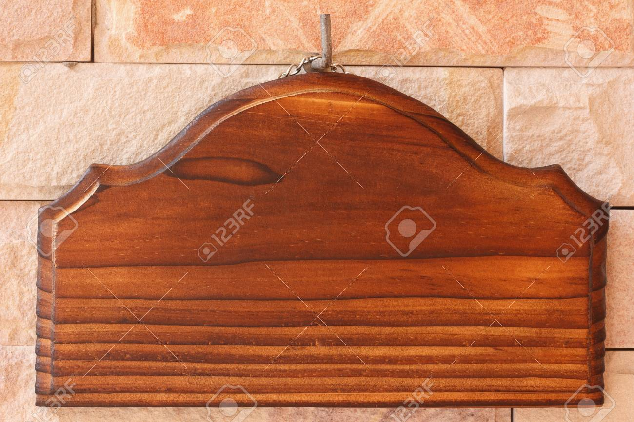 blank wooden signboard hanging on sandstone Stock Photo - 17236272