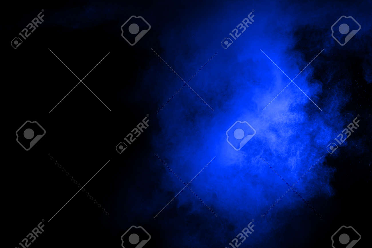 abstract blue powder splatted background,Freeze motion of color powder exploding/throwing color powder,color glitter texture on black background. - 165548327