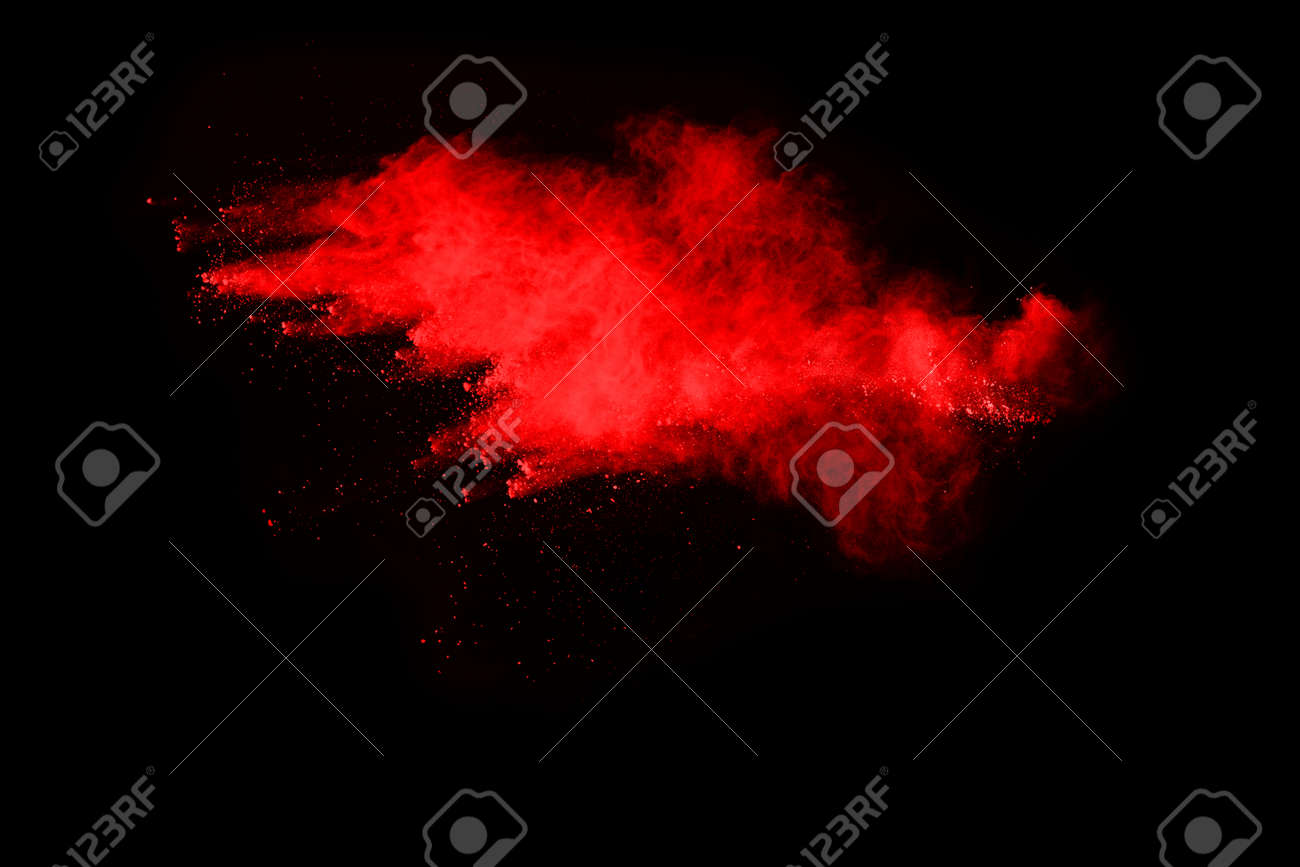 abstract red powder explosion on black background.abstract red powder splatted on black background. Freeze motion of red powder exploding. - 165647246