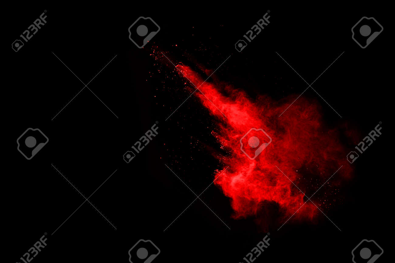 abstract red powder explosion on black background.abstract red powder splatted on black background. Freeze motion of red powder exploding. - 165655470