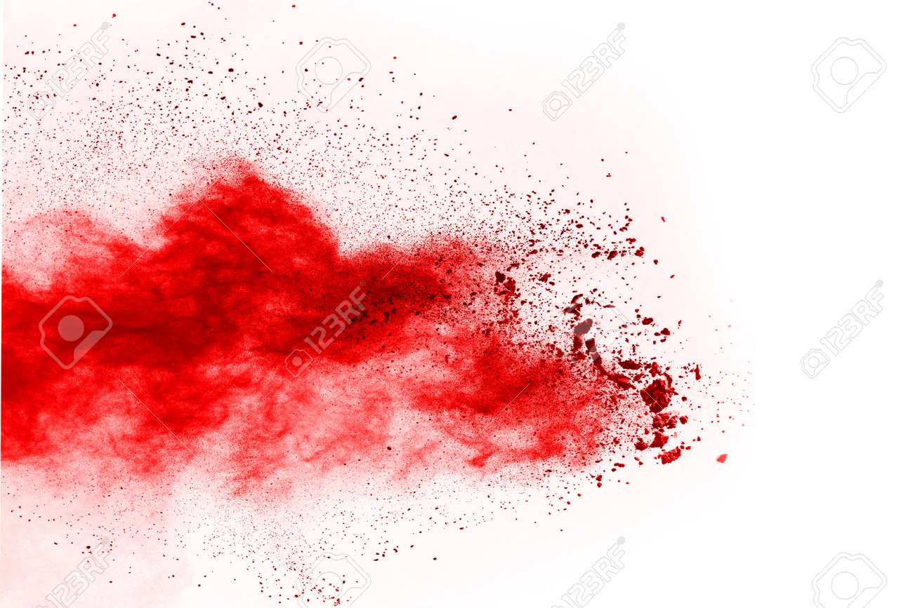 Freeze motion of red powder exploding, isolated on white background. Abstract design of red dust cloud. Particles explosion screen saver, wallpaper - 165746918