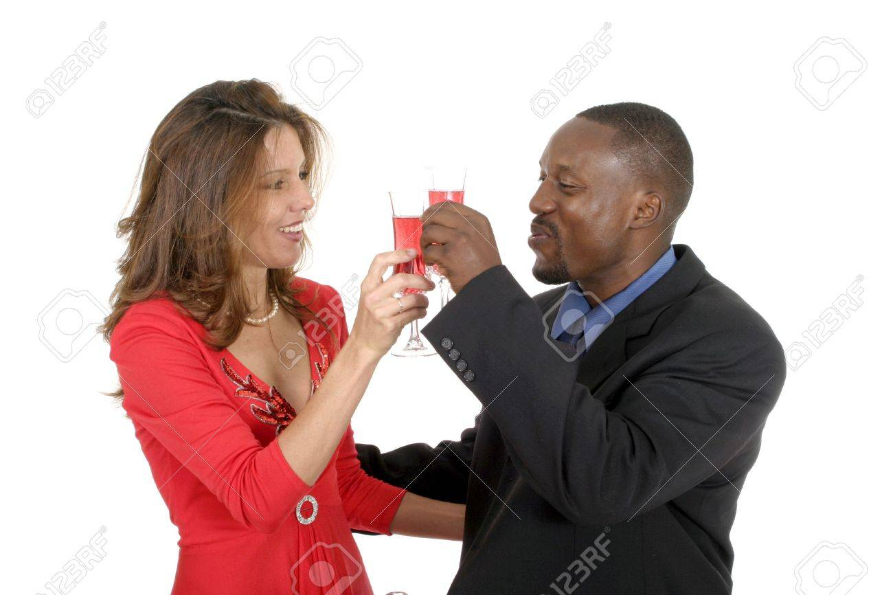 Handsome man and beautiful woman celebrating a romantic occasion with a bottle of champagne or sparking wine. Stock Photo - 466685