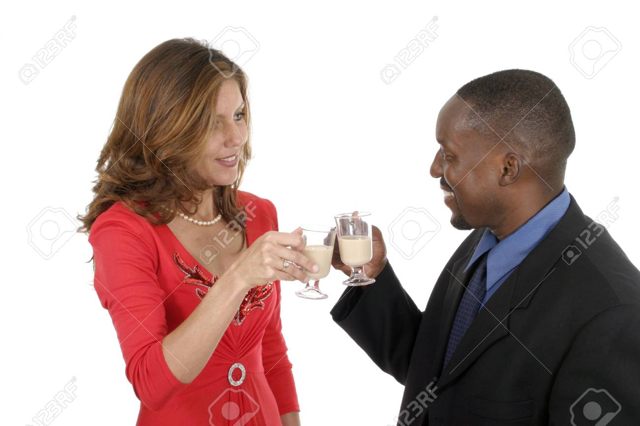 Man and woman celebrating a romantic occasion with a glass of Irish creme liqueur. Stock Photo - 474615