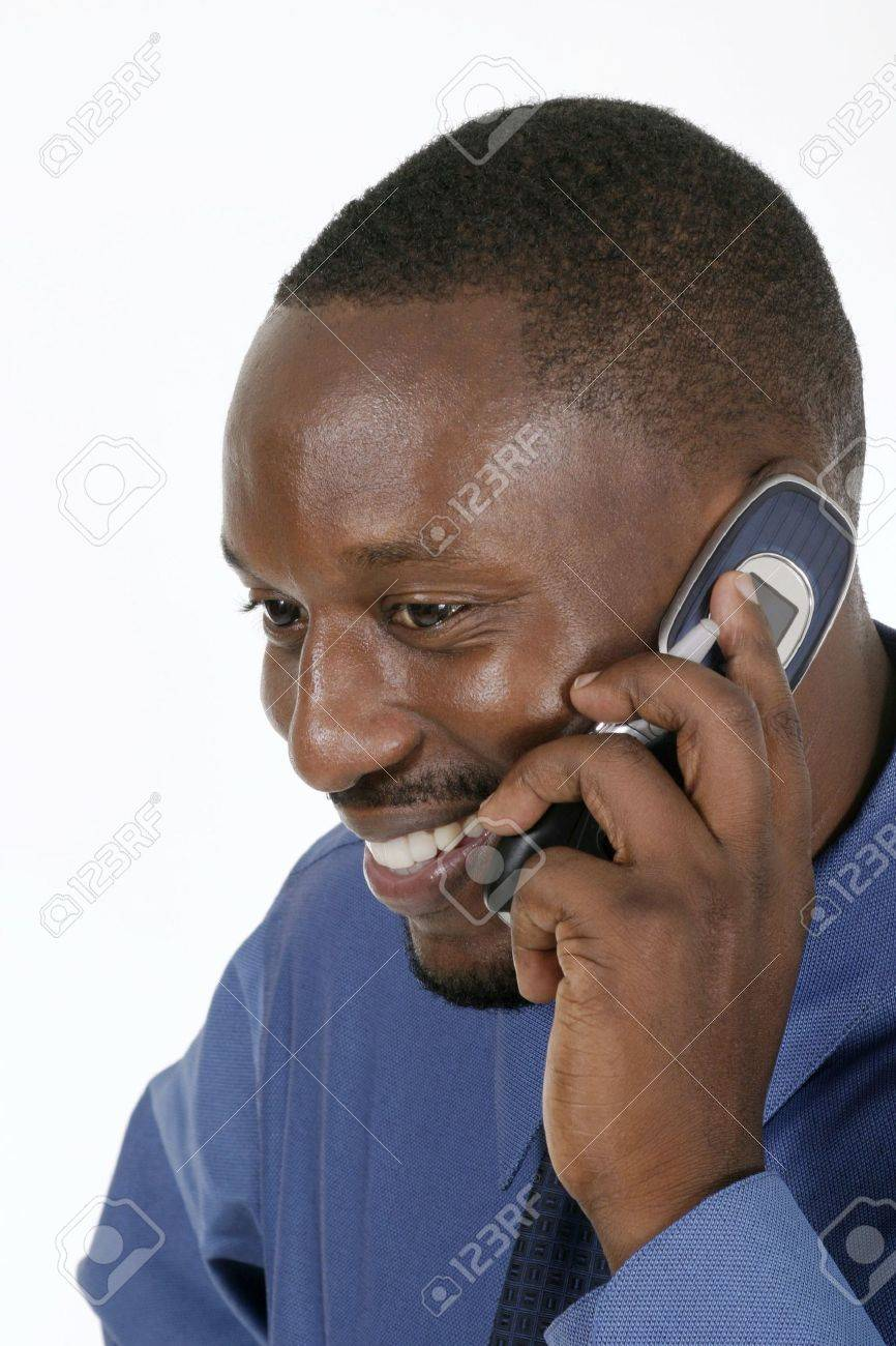 Smiling professional, business man, teacher, or medical doctor smiling and talking on a cellphone. Stock Photo - 565744