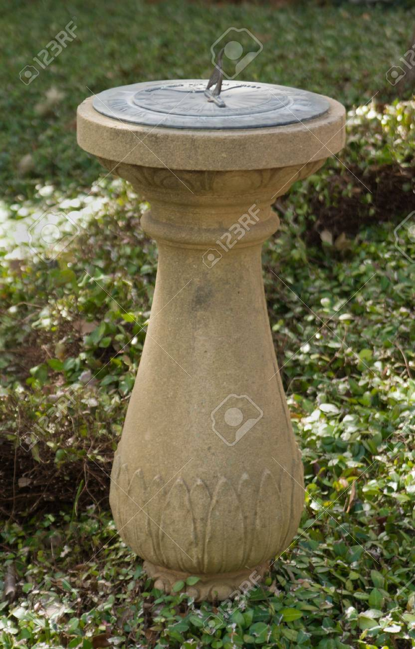 Classic Ornamental Sundial In A Garden Surrounded By Ivy. Stock ...