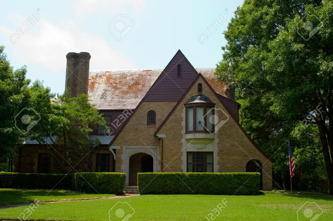 Tudor Style brick house with dramatically pitched roofline Stock Photo - 800158