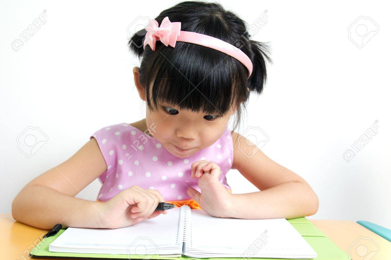 Little kid is looking at her book surprisingly - 14471006