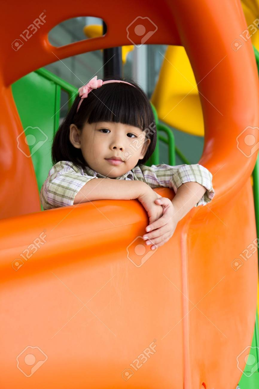 Child plays on slide at an indoor playground Stock Photo - 15518375