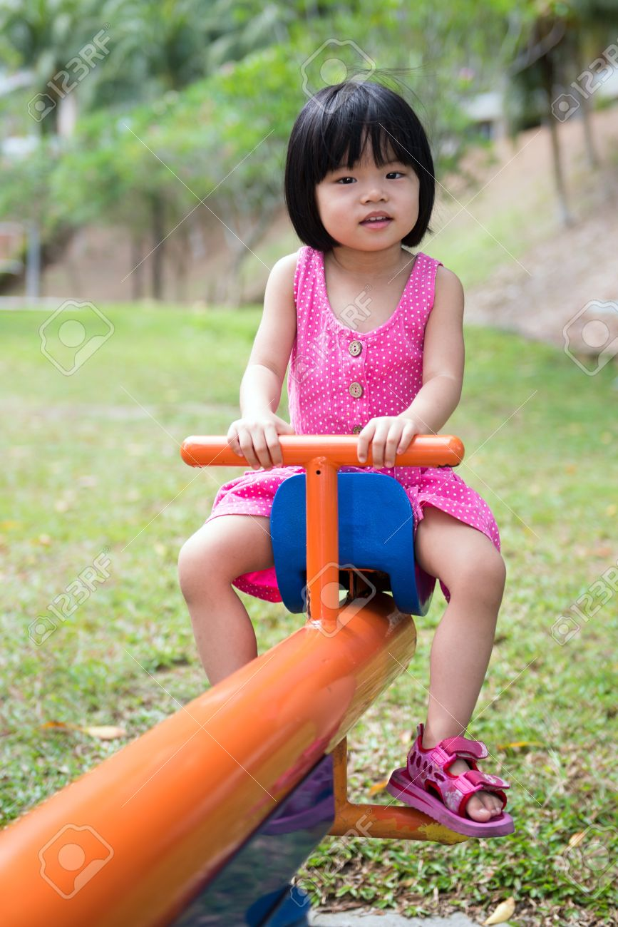 Child plays in an outdoor playground Stock Photo - 19226251
