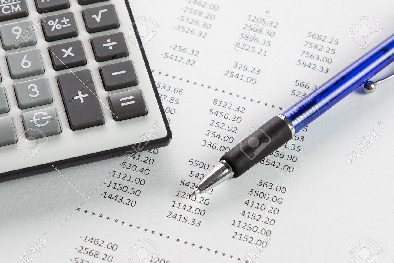 Finance analysis concept using finance report with pen and calculator Stock Photo - 21195372