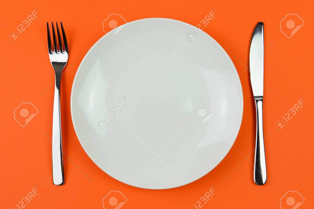 An Arrangement Of A White Dinner Plate With Fork And Knife Isolated Stock Photo Picture And Royalty Free Image Image 25311960