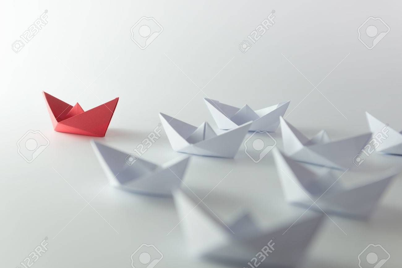 Leadership concept using red paper ship among white Stock Photo - 32555769